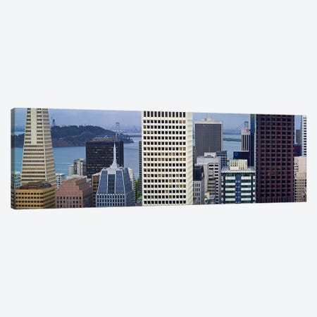 Skyscrapers in the financial district with the bay bridge in the background, San Francisco, California, USA 2011 Canvas Print #PIM9890} by Panoramic Images Canvas Print
