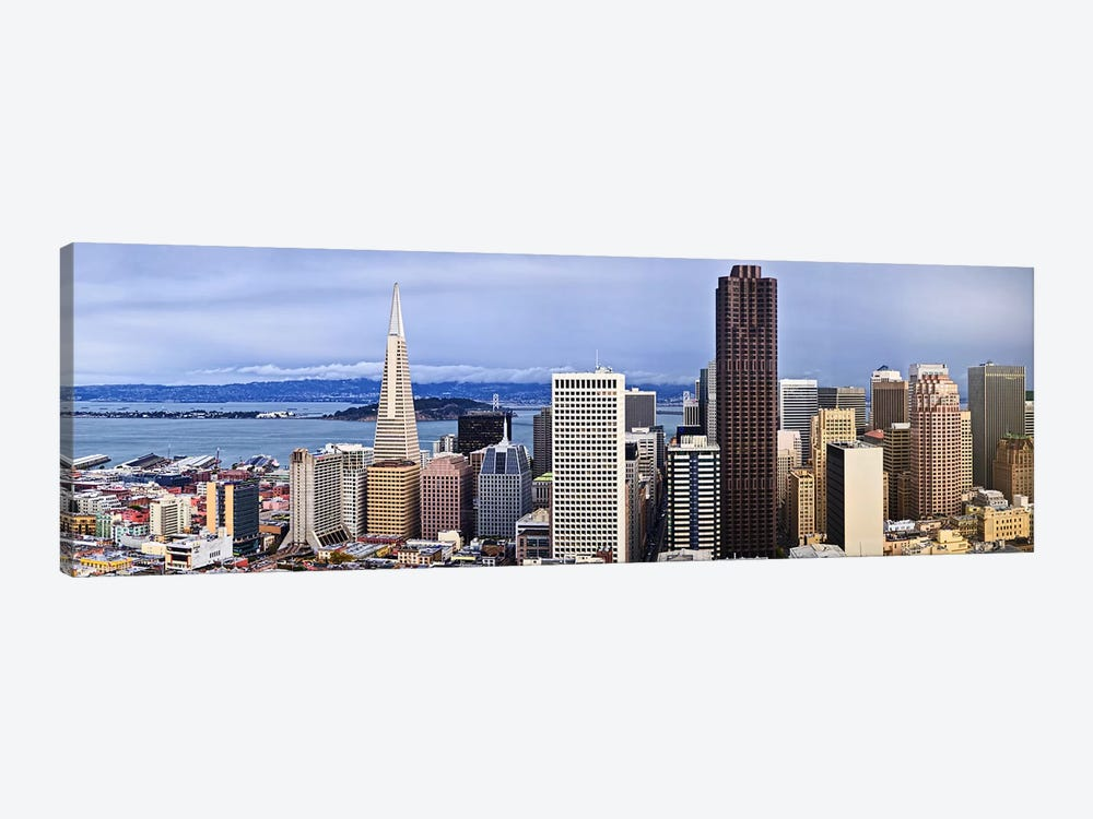 Skyscrapers in the city with the Oakland Bay Bridge in the background, San Francisco, California, USA 2011 by Panoramic Images 1-piece Art Print