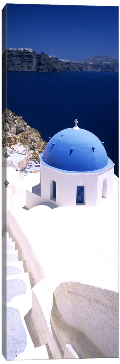 High angle view of a church with blue dome, Oia, Santorini, Cyclades Islands, Greece Canvas Art Print
