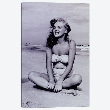 A Young, Smiling Marilyn Monroe Sitting On The Beach Canvas Print #RAD119} by Radio Days Canvas Art