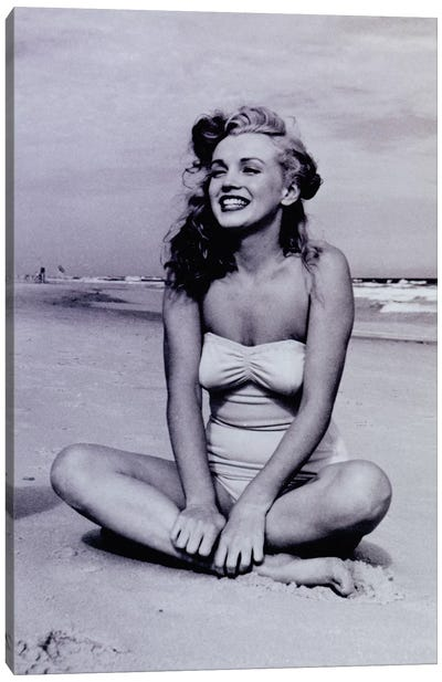 A Young, Smiling Marilyn Monroe Sitting On The Beach Canvas Art Print