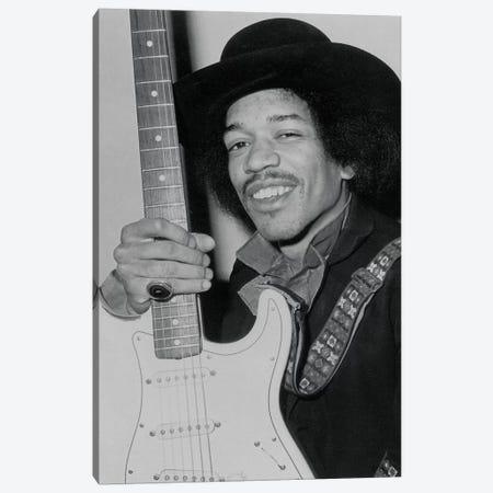 A Smiling Jimi Hendrix Holding His Guitar Canvas Print #RAD53} by Radio Days Canvas Print