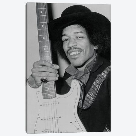 A Smiling Jimi Hendrix Holding His Guitar Canvas Print #RAD53} by Radio Days Canvas Print