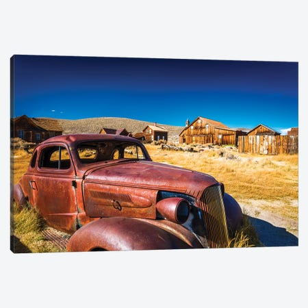 Rusted car and buildings, Bodie State Historic Park, California, USA Canvas Print #RBS24} by Russ Bishop Canvas Artwork