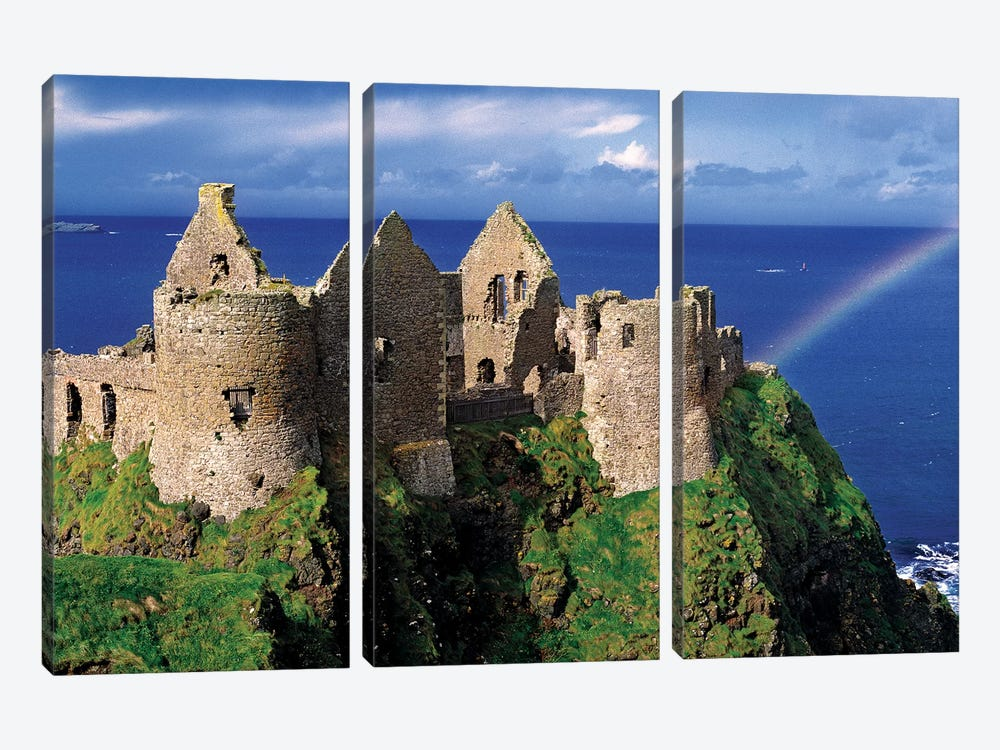 A Rainbow Strikes Medieval Dunluce Castle On The Antrim Coast In Co. Antrim In Northern Ireland. by Ric Ergenbright 3-piece Canvas Artwork