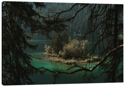Forest Island In A Mountain Lake Framed By Branches Canvas Art Print