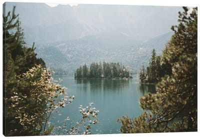 Forest Island In A Mountain Lake Framed By Trees On A Sunny And Hazy Day Canvas Art Print