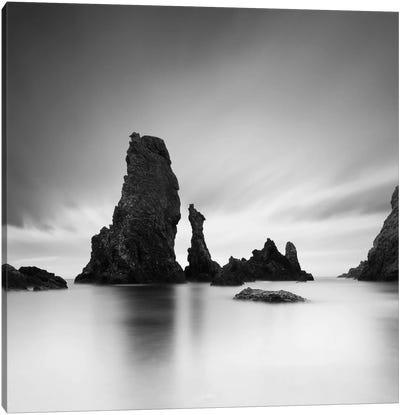 Dark rocks in a blue ocean under cloudy sky in a bad weather #7 Canvas Print #SDG26