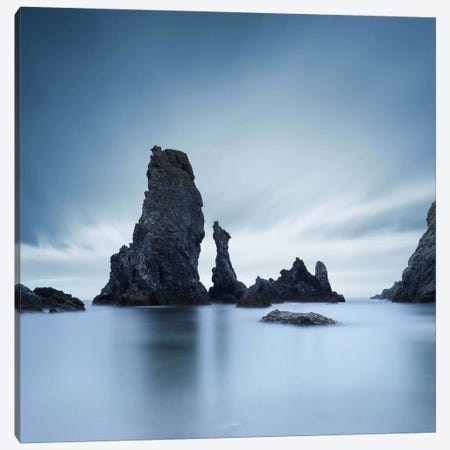 Dark rocks in a blue ocean under cloudy sky in a bad weather. Canvas Print #SDG27} by Sebastien Del Grosso Canvas Wall Art