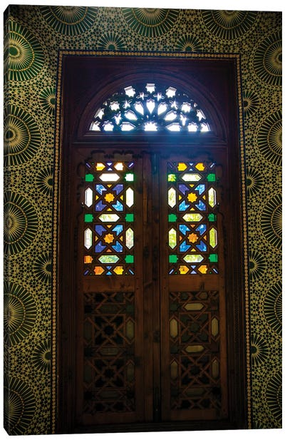 Marrakech, Morocco. Moroccan stained glass in wooden door Canvas Art Print