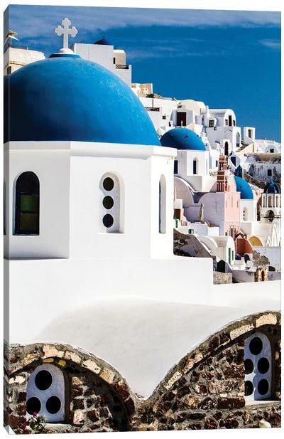 Oia, Greece. Row of Greek Orthodox Churches with blue domes. Canvas Art Print
