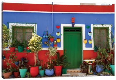Asilah, Morocco. Multi-colored house with potted plants Canvas Art Print