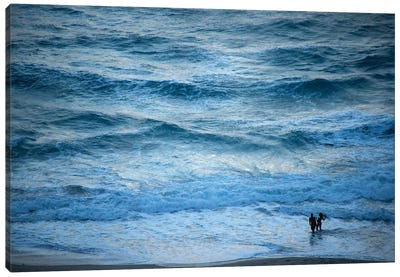 A Couple Plays In The Ocean Waves At Dusk At Riviera Beach Canvas Art Print
