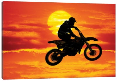A Jumping Motocross Racer In Front Of The Sun Canvas Art Print