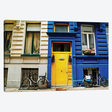 Yellow Door With Bikes Canvas Print #SUV301} by Susan Vizvary Canvas Wall Art