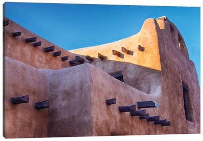 USA, New Mexico, Sant Fe, Adobe structure with protruding vigas and Snow Canvas Art Print