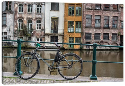Bike along rail in the historic medieval city of Ghent Canvas Art Print