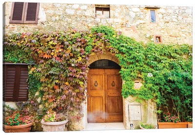 Typical house in Tuscan medieval village of Monteriggioni Canvas Art Print