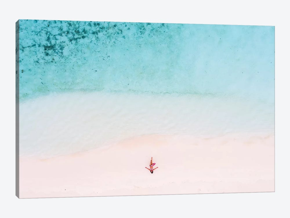Woman Relaxing On Beach, Maldives by Matteo Colombo 1-piece Canvas Print