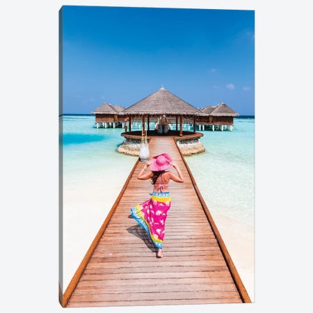 Woman With Sarong Walking On Jetty, Maldives Canvas Print #TEO331} by Matteo Colombo Canvas Wall Art