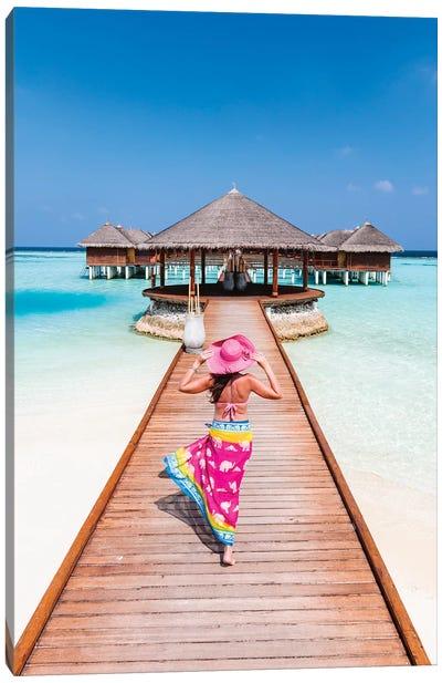 Woman With Sarong Walking On Jetty, Maldives Canvas Art Print