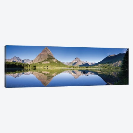 Mountains reflected in lake. Glacier National Park. Montana. Usa. Canvas Print #TNO15} by Tom Norring Canvas Print