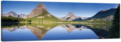 Mountains reflected in lake. Glacier National Park. Montana. Usa. Canvas Art Print