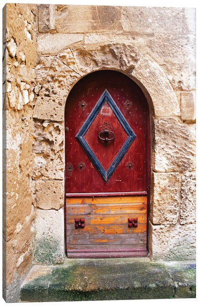 Colorful door in the stone wall of a chateau in France. Canvas Art Print