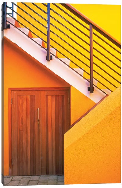 Geometric view of a yellow and orange stairway. Canvas Art Print