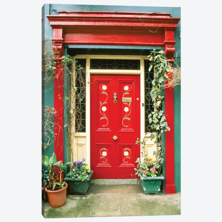 Red door with painted daisies, surrounded by flowers and vines. Canvas Print #TOH3} by Tom Haseltine Canvas Wall Art