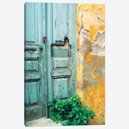 Red lock on a weathered blue door. Canvas Print #TOH4} by Tom Haseltine Art Print