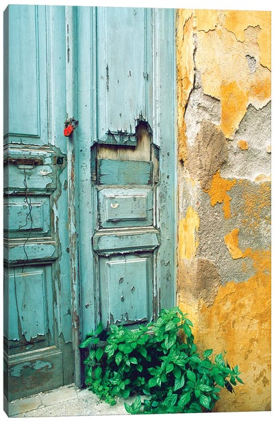 Red lock on a weathered blue door. Canvas Art Print