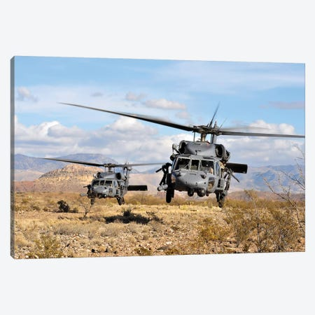 Two HH-60 Pave Hawk Helicopters Preparing To Land Canvas Print #TRK1000} by Stocktrek Images Canvas Wall Art