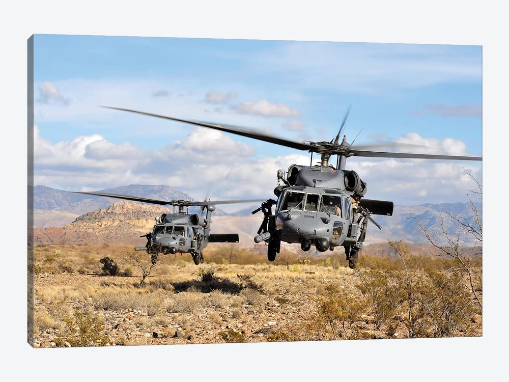 Two HH-60 Pave Hawk Helicopters Preparing To Land by Stocktrek Images 1-piece Canvas Print