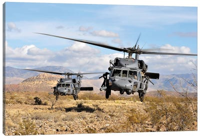 Two HH-60 Pave Hawk Helicopters Preparing To Land Canvas Art Print