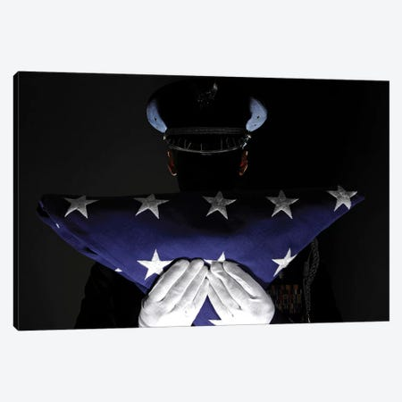 US Airman Stands At Attention After Completing The Flag Dressing Sequence Canvas Print #TRK1011} by Stocktrek Images Art Print