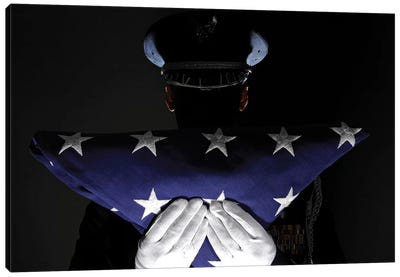 US Airman Stands At Attention After Completing The Flag Dressing Sequence Canvas Art Print