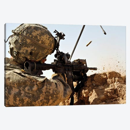 US Army Soldier Engages Enemy Forces In A Small Arms Fire Fight In Afghanistan Canvas Print #TRK1017} by Stocktrek Images Canvas Artwork