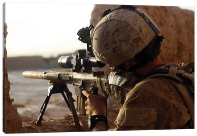 US Marine Looks Through The Scope Of His M16A4 Rifle For Enemy Forces Canvas Art Print
