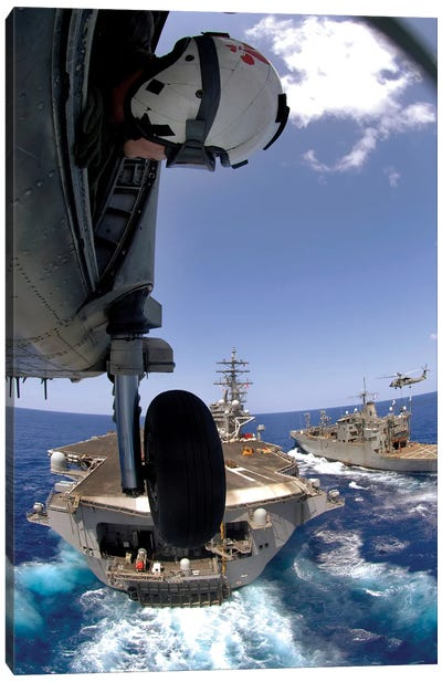 US Navy Petty Officer Leans Out The Door Of An SH-60 Seahawk Canvas Art Print
