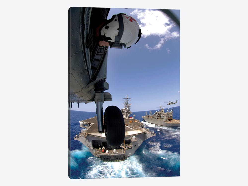 US Navy Petty Officer Leans Out The Door Of An SH-60 Seahawk 1-piece Canvas Art Print