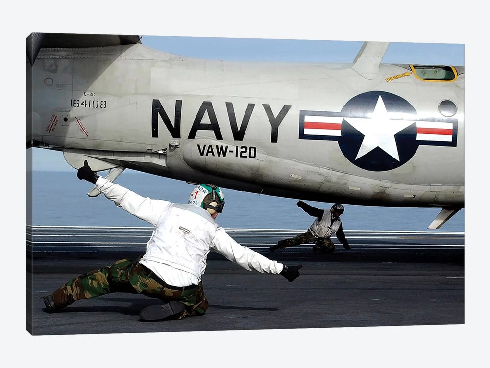 US Navy Sailors Give The Thumbs Up Signal Before Launching A E-2C Hawkeye by Stocktrek Images 1-piece Canvas Print