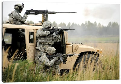 US Soldiers Perform A Platoon Mounted And Dismounted Live-Fire Exercise Canvas Art Print