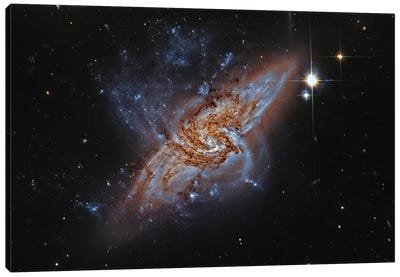 A Pair Of Overlapping Spiral Galaxies (NGC 3314) Canvas Art Print