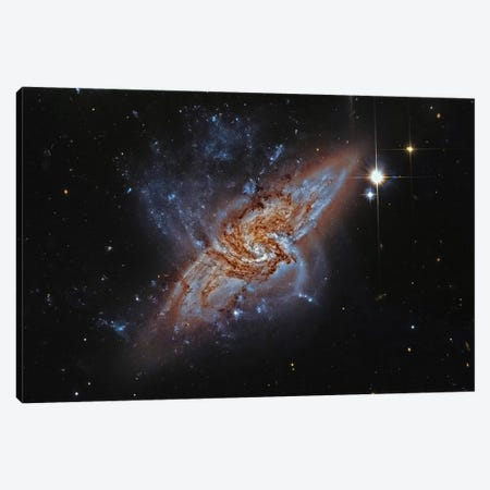 A Pair Of Overlapping Spiral Galaxies (NGC 3314) Canvas Print #TRK1312} by Roberto Colombari Canvas Wall Art