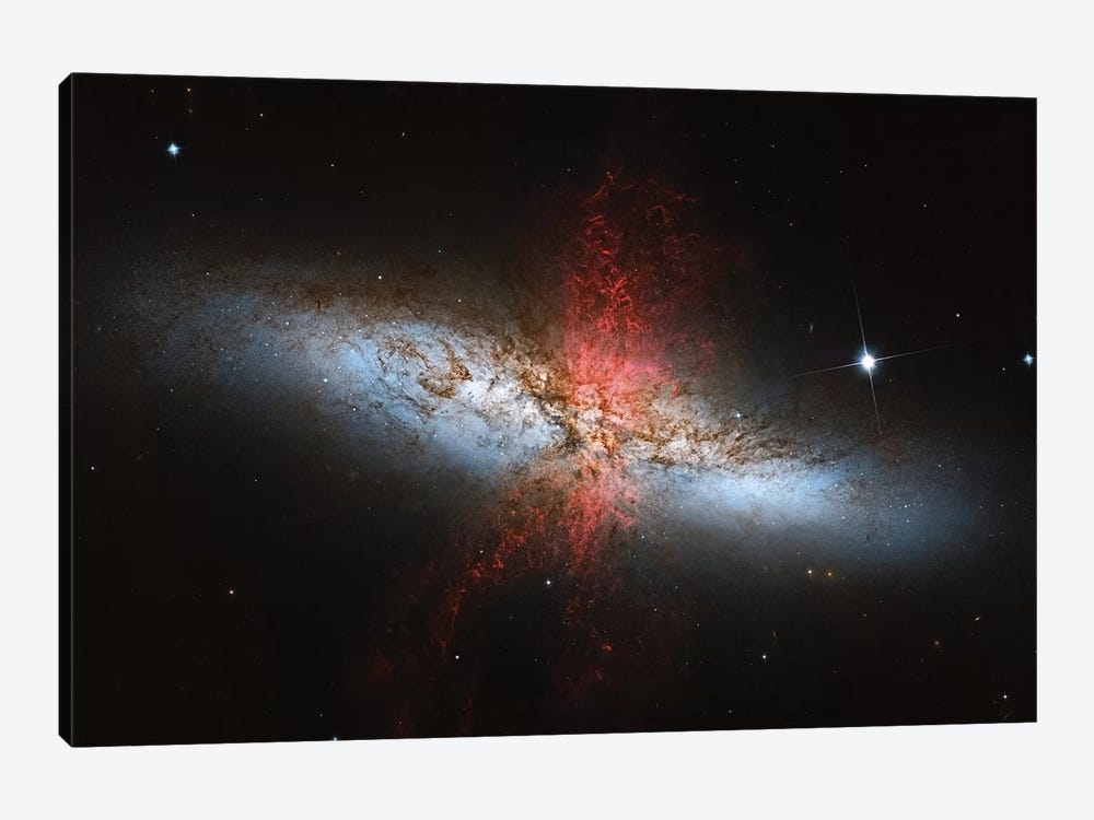 A Starburst Galaxy (M82) In The Ursa Major Constellation by Roberto Colombari 1-piece Canvas Art Print
