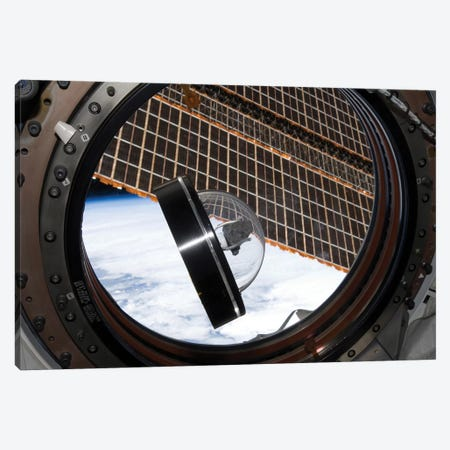A Moon Rock Floats Aboard The International Space Station Canvas Print #TRK1398} by Stocktrek Images Canvas Wall Art
