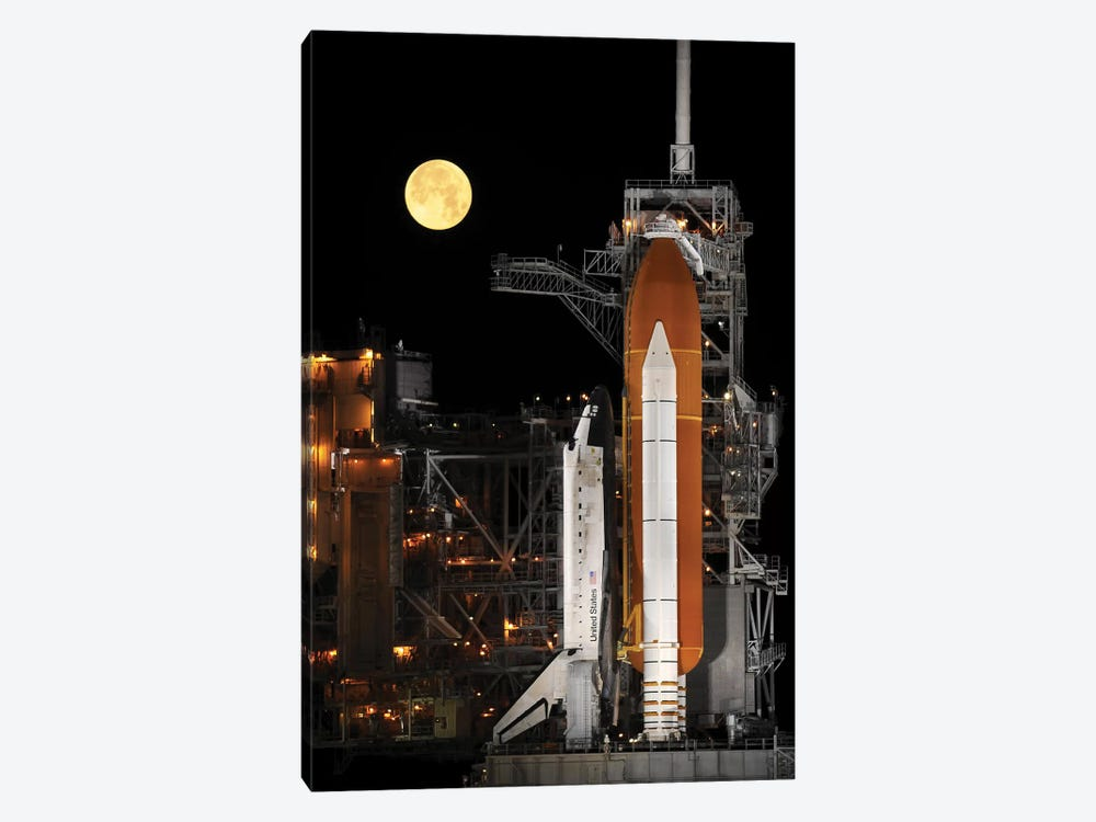 A Nearly Full Moon Sets As Space Shuttle Discovery Sits Atop The Launch Pad by Stocktrek Images 1-piece Art Print