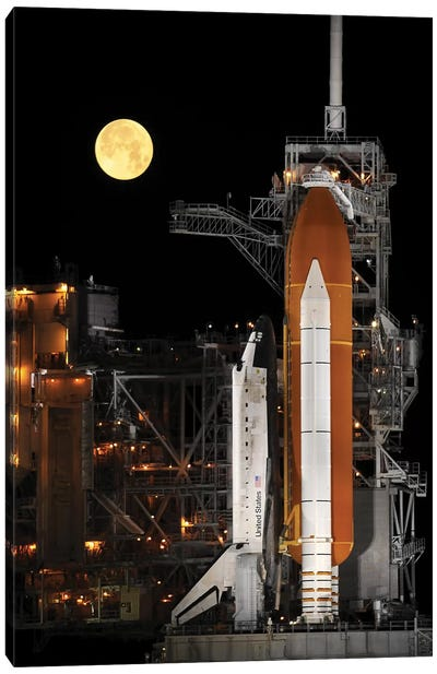 A Nearly Full Moon Sets As Space Shuttle Discovery Sits Atop The Launch Pad Canvas Art Print