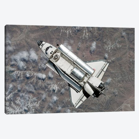 Aerial View Of Space Shuttle Discovery Over Earth As It Approaches The International Space Station Canvas Print #TRK1415} by Stocktrek Images Canvas Wall Art
